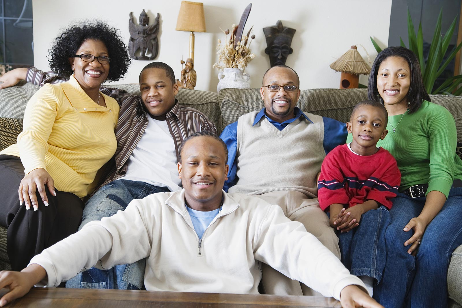 African-American family of six at home in their family room
