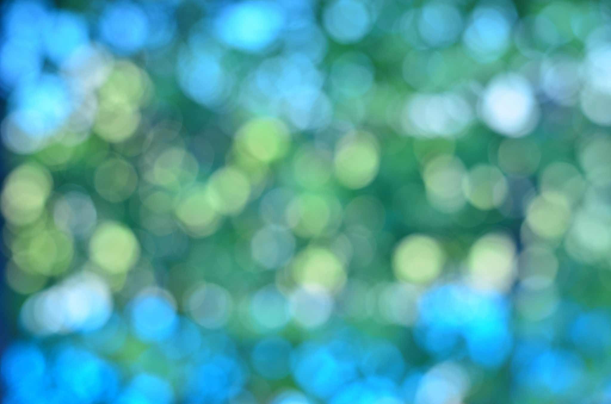 blurry bokeh background of blues and greens