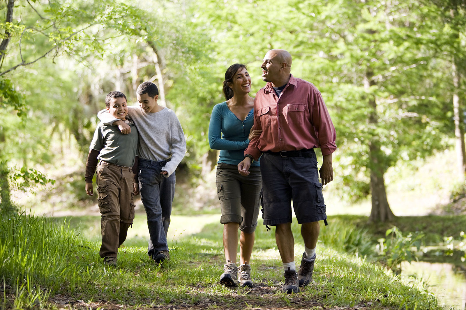Hispanic family with two teen boys on a hike in the park